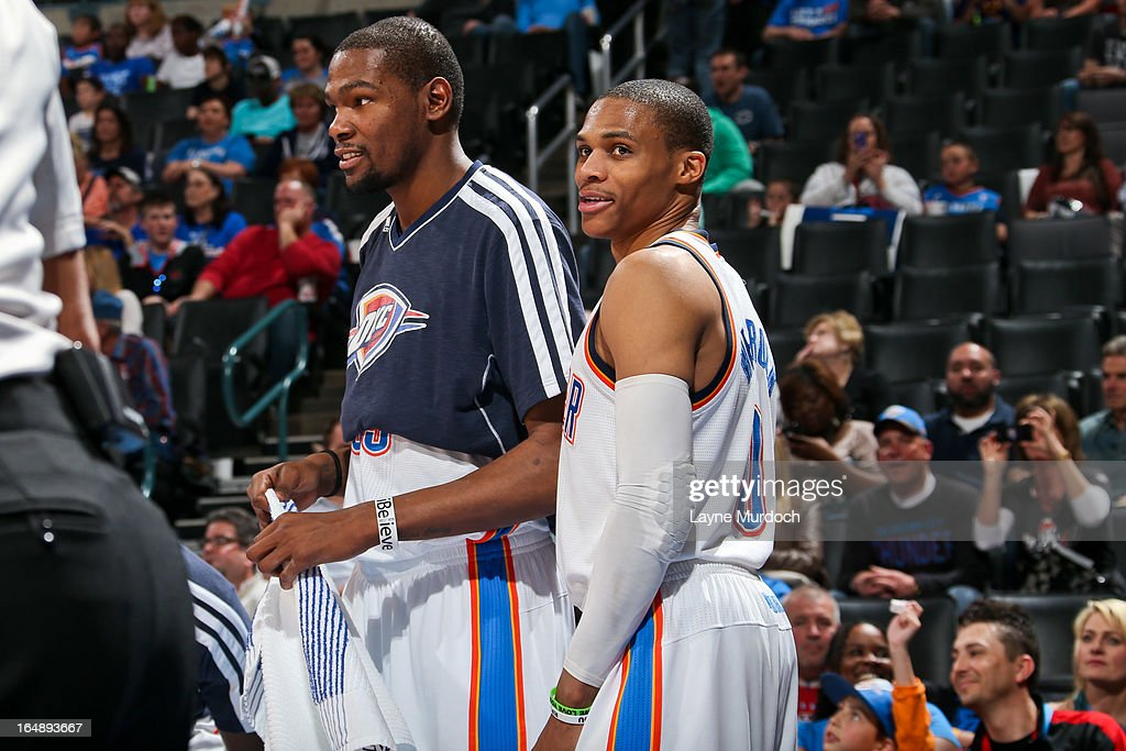 <a gi-track='captionPersonalityLinkClicked' href=/galleries/search?phrase=Russell+Westbrook&family=editorial&specificpeople=4044231 ng-click='$event.stopPropagation()'>Russell Westbrook</a> #0 and <a gi-track='captionPersonalityLinkClicked' href=/galleries/search?phrase=Kevin+Durant&family=editorial&specificpeople=3847329 ng-click='$event.stopPropagation()'>Kevin Durant</a> #35 of the Oklahoma City Thunder celebrate from the sideline during a game against the Washington Wizards on March 27, 2013 at the Chesapeake Energy Arena in Oklahoma City, Oklahoma.