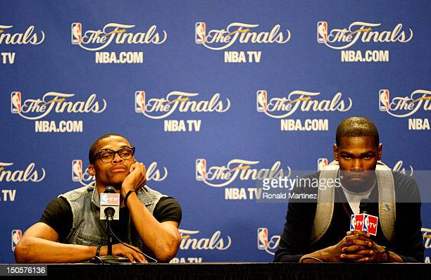 Russell Westbrook and Kevin Durant of the Oklahoma City Thunder look on dejected during their post game press conference against the Miami Heat in...