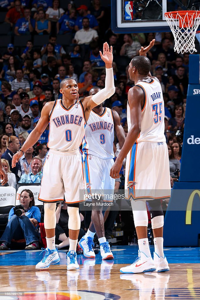 <a gi-track='captionPersonalityLinkClicked' href=/galleries/search?phrase=Russell+Westbrook&family=editorial&specificpeople=4044231 ng-click='$event.stopPropagation()'>Russell Westbrook</a> #0 and <a gi-track='captionPersonalityLinkClicked' href=/galleries/search?phrase=Kevin+Durant&family=editorial&specificpeople=3847329 ng-click='$event.stopPropagation()'>Kevin Durant</a> #35 of the Oklahoma City Thunder celebrate while playing against the Portland Trail Blazers on November 2, 2012 at the Chesapeake Energy Arena in Oklahoma City, Oklahoma.
