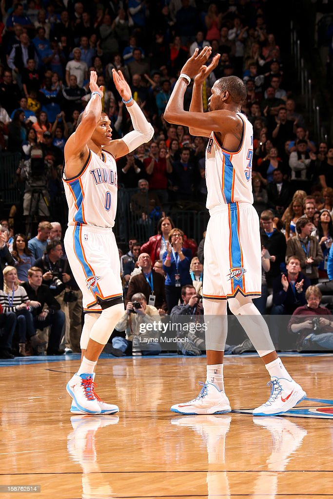 Russell Westbrook #0 and Kevin Durant #35 of the Oklahoma City Thunder celebrate while playing the Dallas Mavericks on December 27, 2012 at the Chesapeake Energy Arena in Oklahoma City, Oklahoma.