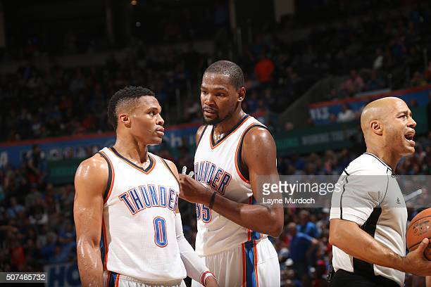 Russell Westbrook and Kevin Durant of the Oklahoma City Thunder talk during the game against the Houston Rockets on January 29 2016 at Chesapeake...