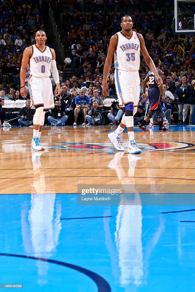 Russell Westbrook #0 and Kevin Durant #35 of the Oklahoma City Thunder wait to resume action against the Atlanta Hawks on November 4, 2012 at the Chesapeake Energy Arena in Oklahoma City, Oklahoma.