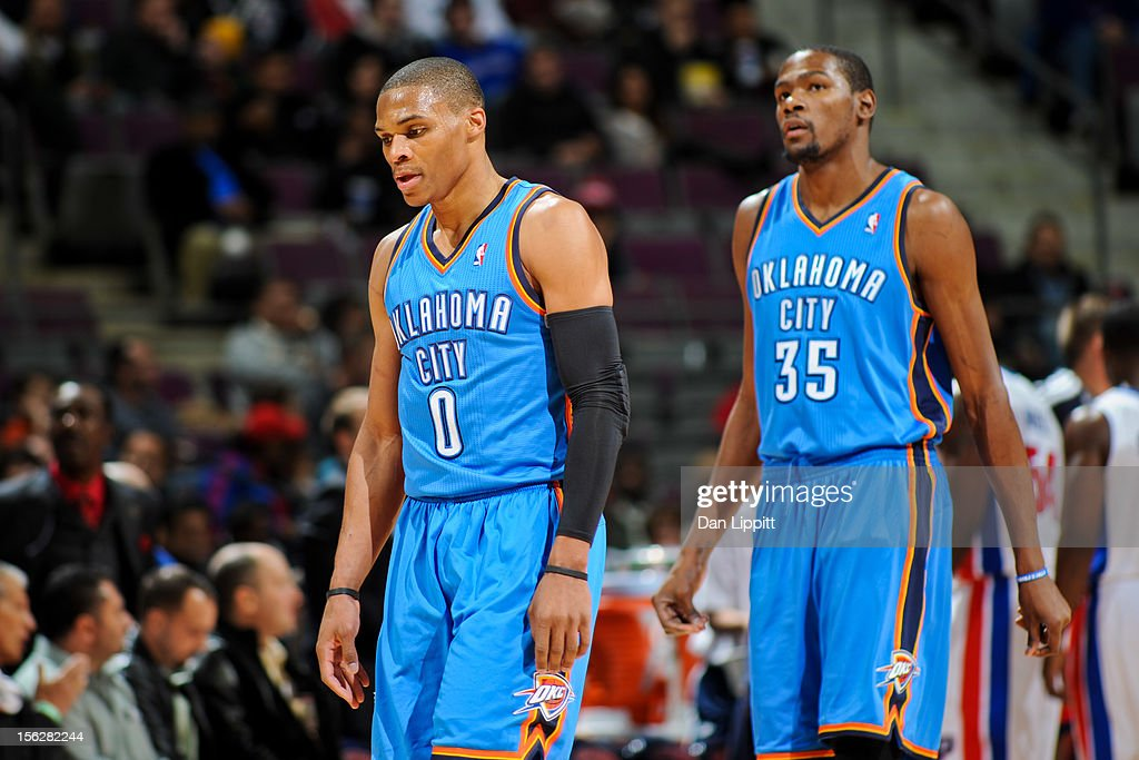 Russell Westbrook #0 and Kevin Durant #35 of the Oklahoma City Thunder walk to the sideline during a timeout against the Detroit Pistons on November 12, 2012 at The Palace of Auburn Hills in Auburn Hills, Michigan.