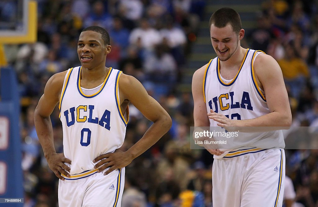 Russell Westbrook #0 and Kevin Love #42 of the UCLA Bruins celebrate during game against the Arizona Wildcats at Pauley Pavilion on February 2, 2008 in Westwood, California.