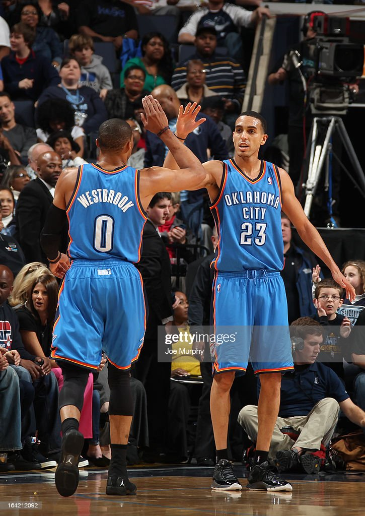 Russell Westbrook #0 and Kevin Martin #23 of the Oklahoma City Thunder celebrate during the game against the Memphis Grizzlies on March 20, 2013 at FedExForum in Memphis, Tennessee.
