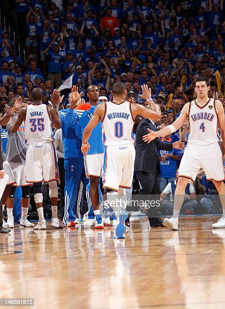Russell Westbrook and Nick Collison of the Oklahoma City Thunder celebrate a play against the Miami Heat during Game Two of the 2012 NBA Finals at...