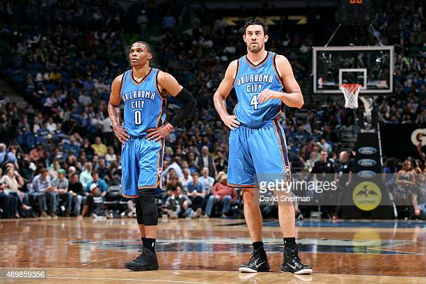 Russell Westbrook and Nick Collison of the Oklahoma City Thunder stand on the court during a game against the Minnesota Timberwolves on April 15 2015...
