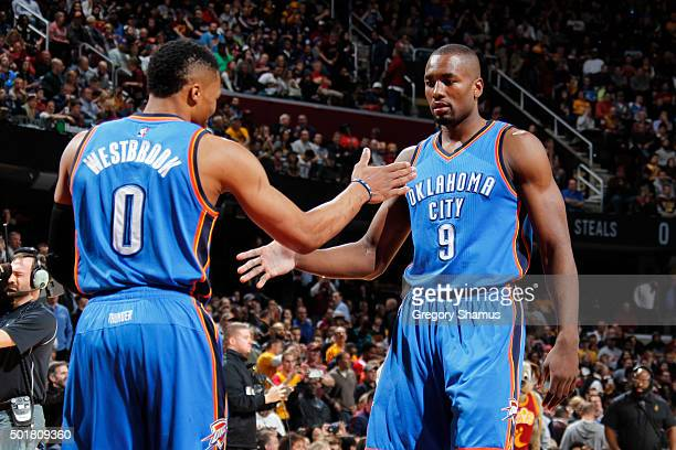 Russell Westbrook and Serge Ibaka of the Oklahoma City Thunder before the game against the Cleveland Cavaliers on December 17 2015 at Quicken Loans...