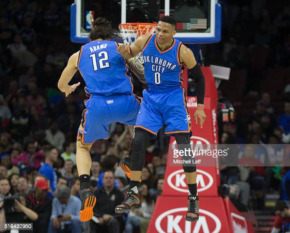Russell Westbrook and Steven Adams of the Oklahoma City Thunder celebrate against the Philadelphia 76ers on March 18 2016 at the Wells Fargo Center...