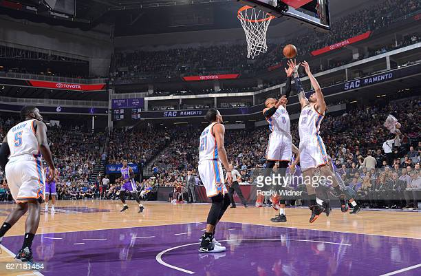 Russell Westbrook and Steven Adams of the Oklahoma City Thunder rebound against the Sacramento Kings on November 23 2016 at Golden 1 Center in...