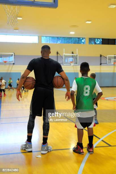 Russell Westbrook awards kids at the Russell Westbrook 5th Annual Why Not Foundation Basketball Camp at Jesse Owens Community Regional Park on July...