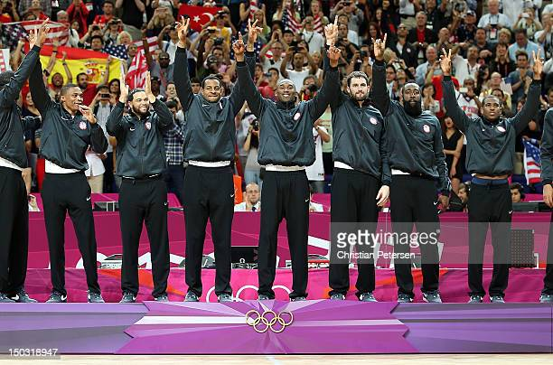 Russell Westbrook Deron Williams Andre Iguodala Kobe Bryant Kevin Love James Harden and Chris Paul of United States pose together on the podium after...
