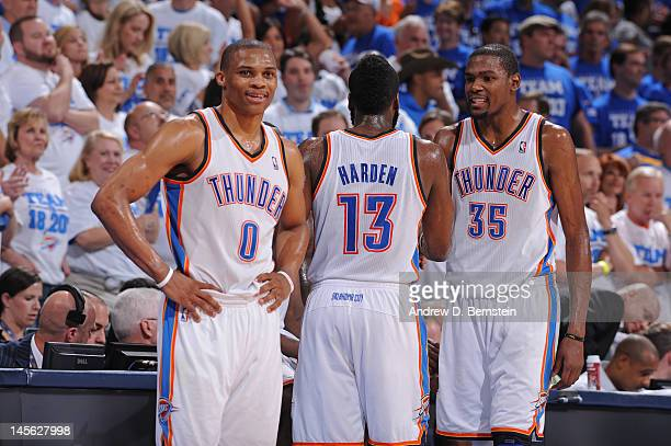 Russell Westbrook James Harden and Kevin Durant of the Oklahoma City Thunder celebrate a play against the San Antonio Spurs in Game Four of the...