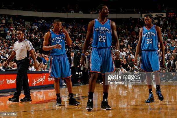 Russell Westbrook Jeff Green and Kevin Durant of the Oklahoma City Thunder walk across the court during the game against the Dallas Mavericks on...