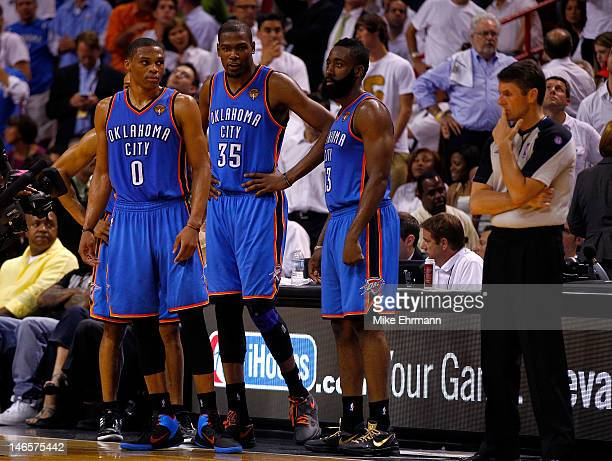 Russell Westbrook Kevin Durant and James Harden of the Oklahoma City Thunder look on in the second half against the Miami Heat in Game Four of the...
