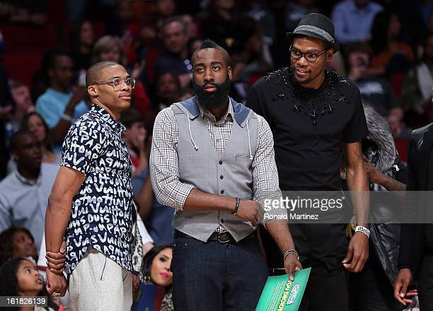 Russell Westbrook of Oklahoma City Thunder James Harden of the Houston Rockets and Kevin Durant of the Thunder watch the Sprite Slam Dunk Contest...