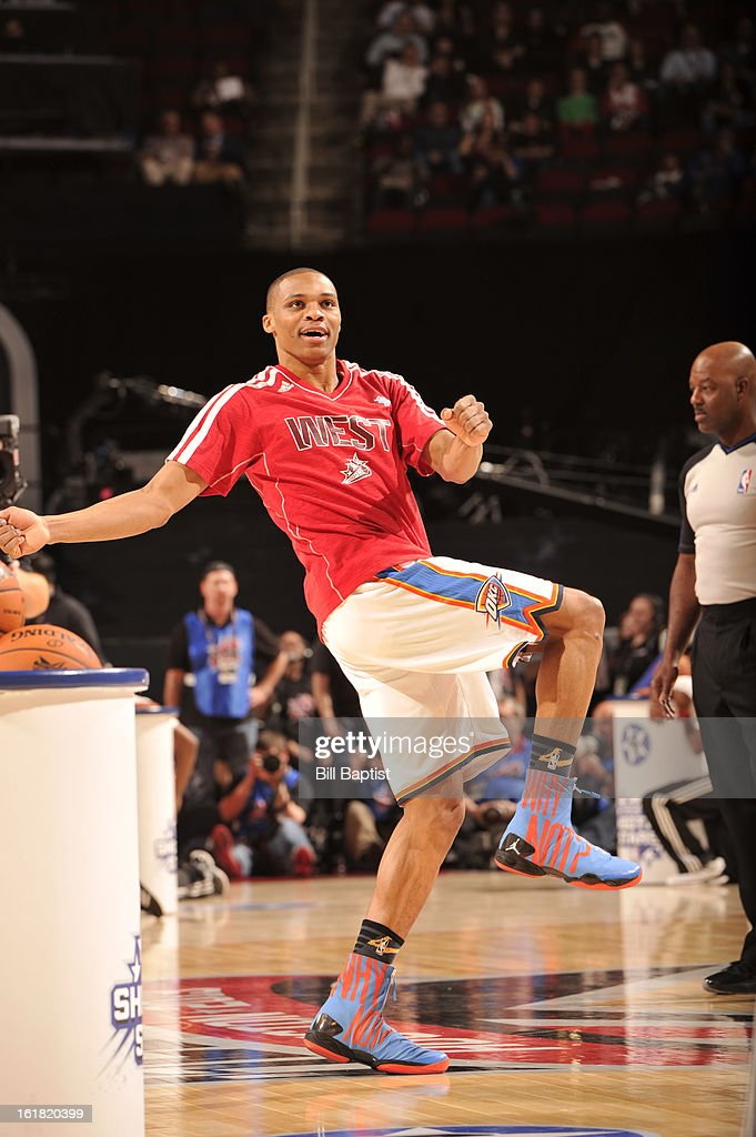 <a gi-track='captionPersonalityLinkClicked' href=/galleries/search?phrase=Russell+Westbrook&family=editorial&specificpeople=4044231 ng-click='$event.stopPropagation()'>Russell Westbrook</a> of Team Westbrook reacts to making a basket during 2013 Sears Shooting Stars Competition on State Farm All-Star Saturday Night as part of 2013 NBA All-Star Weekend on February 16, 2013 at Toyota Center in Houston, Texas.