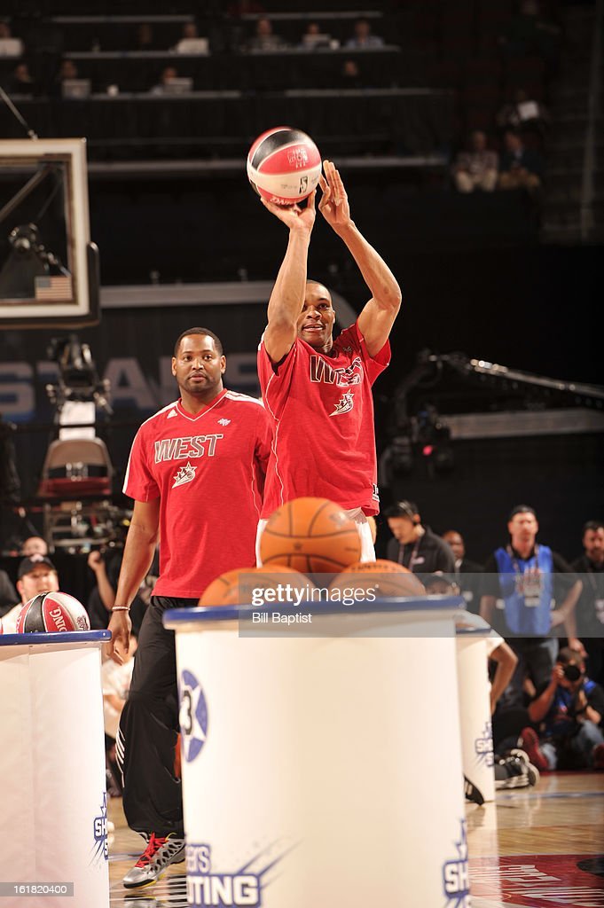 <a gi-track='captionPersonalityLinkClicked' href=/galleries/search?phrase=Russell+Westbrook&family=editorial&specificpeople=4044231 ng-click='$event.stopPropagation()'>Russell Westbrook</a> of Team Westbrook shoots the ball during 2013 Sears Shooting Stars Competition on State Farm All-Star Saturday Night as part of 2013 NBA All-Star Weekend on February 16, 2013 at Toyota Center in Houston, Texas.