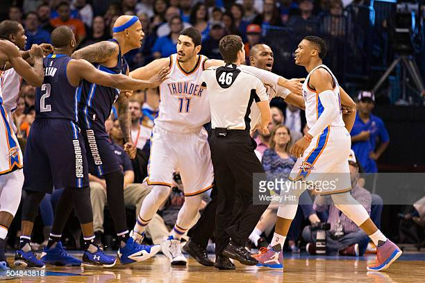 Russell Westbrook of the Dallas Mavericks and Charlie Villanueva of the Oklahoma City Thunder are seperated after a pushing match in the first half...