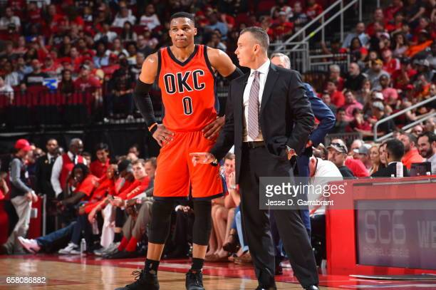 Russell Westbrook of the Houston Rockets looks on with head coach Billy Donovan during a timeout against the Oklahoma City Thunder on March 26 2017...