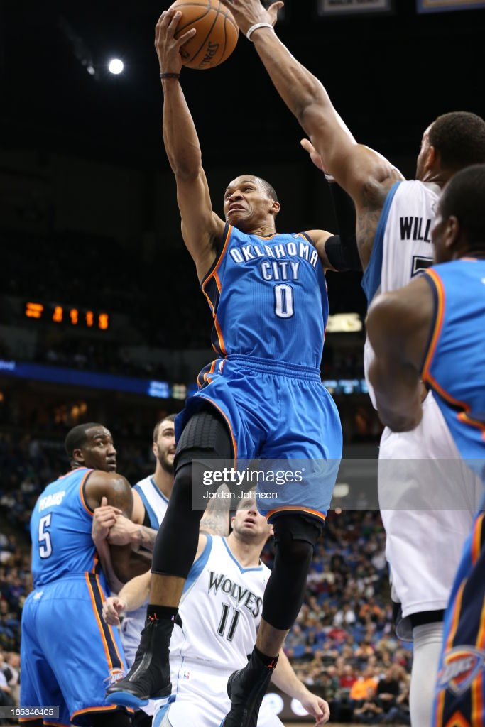Russell Westbrook #0 of the Oklahoma City Thunde drives to the basket against the Minnesota Timberwolves on March 29, 2013 at Target Center in Minneapolis, Minnesota.