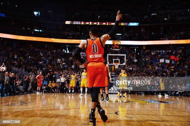 Russell Westbrook of the Oklahoma City Thunder acknowledges the crowd after breaking the NBA record for the most triple doubles in a season during...