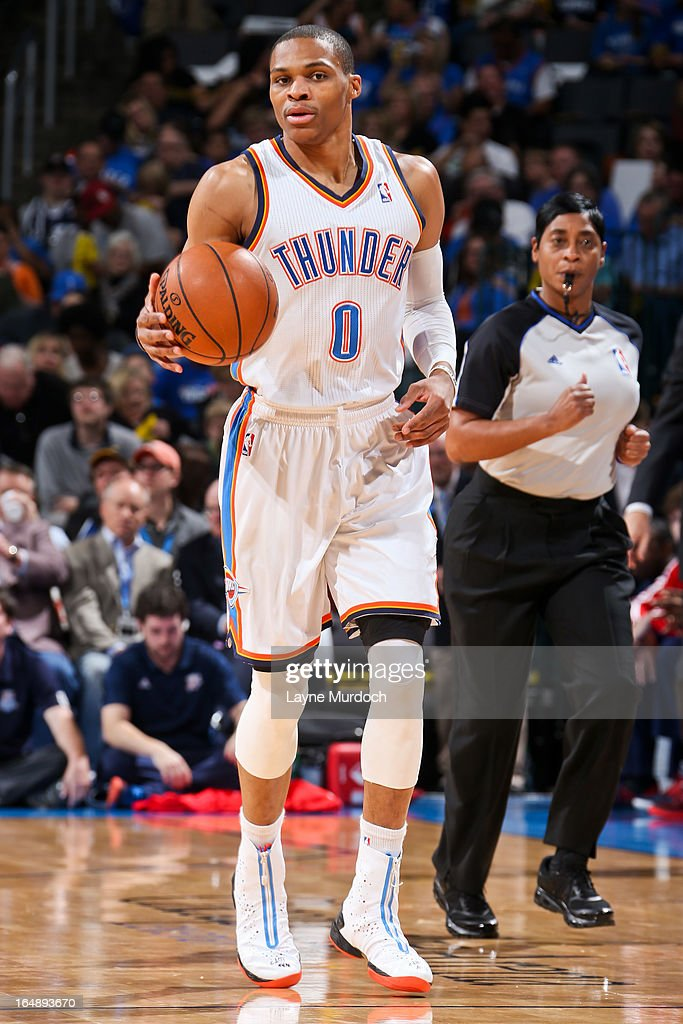 <a gi-track='captionPersonalityLinkClicked' href=/galleries/search?phrase=Russell+Westbrook&family=editorial&specificpeople=4044231 ng-click='$event.stopPropagation()'>Russell Westbrook</a> #0 of the Oklahoma City Thunder advances the ball against the Washington Wizards on March 27, 2013 at the Chesapeake Energy Arena in Oklahoma City, Oklahoma.