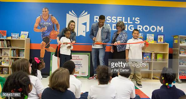 Russell Westbrook of the Oklahoma City Thunder along with Telstar Elementary School teachers and students cut the ribbon to open the Russell...