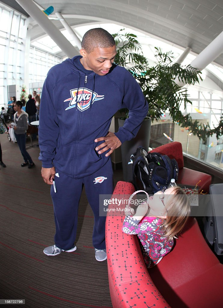 Russell Westbrook #0 of the Oklahoma City Thunder along with the rest of the team, visits patients in the Children's Hospital on December 22, 2012 in Oklahoma City, Oklahoma.