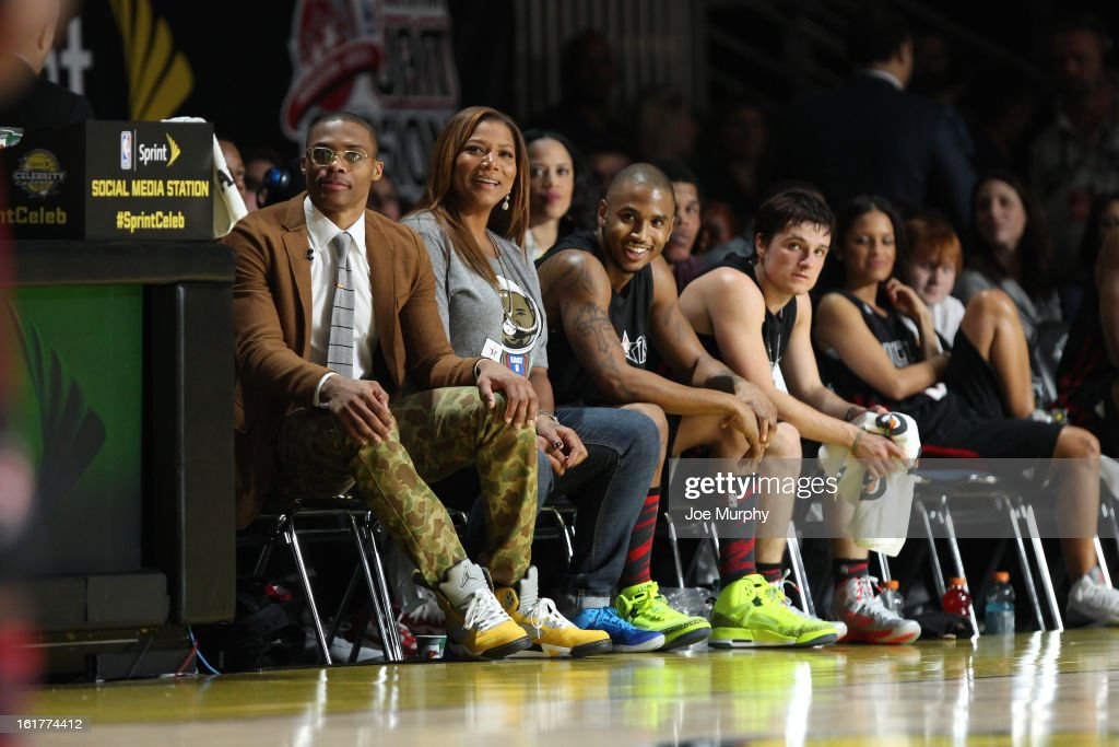 Russell Westbrook of the Oklahoma City Thunder and Actress Queen Latifah Coaches of the East react to a play against the West team during the Sprint NBA All-Star Celebrity Game in Sprint Arena at Jam Session during the NBA All-Star Weekend on February 15, 2013 at the George R. Brown Convention Center in Houston, Texas.