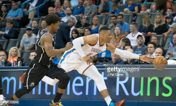 Russell Westbrook of the Oklahoma City Thunder and Casey Prather of Melbourne United in the first half a NBA preseason game at the Chesapeake Energy...