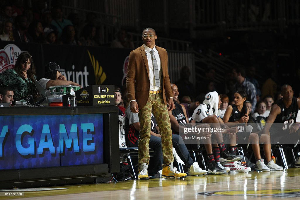 Russell Westbrook of the Oklahoma City Thunder and Coach of the East team reacts to a play against the West team during the Sprint NBA All-Star Celebrity Game in Sprint Arena at Jam Session during the NBA All-Star Weekend on February 15, 2013 at the George R. Brown Convention Center in Houston, Texas.