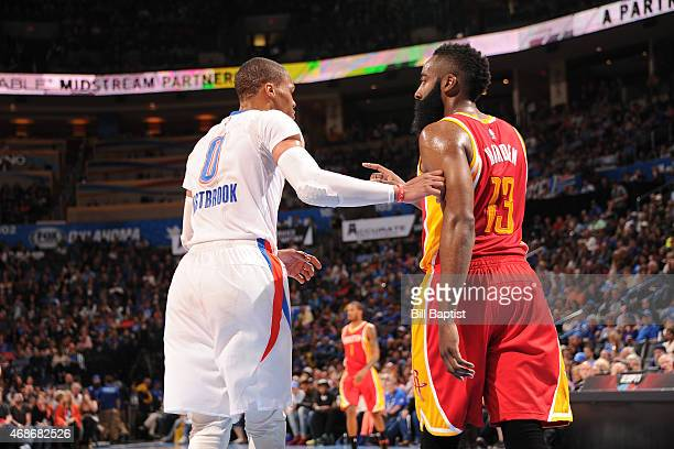 Russell Westbrook of the Oklahoma City Thunder and James Harden of the Houston Rockets during the game on April 5 2015 at Chesapeake Energy Arena in...