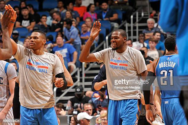 Russell Westbrook of the Oklahoma City Thunder and Kevin Durant of the Oklahoma City Thunder shakes hands with their teammates against the Orlando...