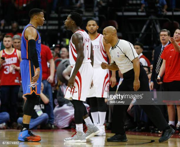 Russell Westbrook of the Oklahoma City Thunder and Patrick Beverley of the Houston Rockets confront each other in the fourth quarter during Game Five...
