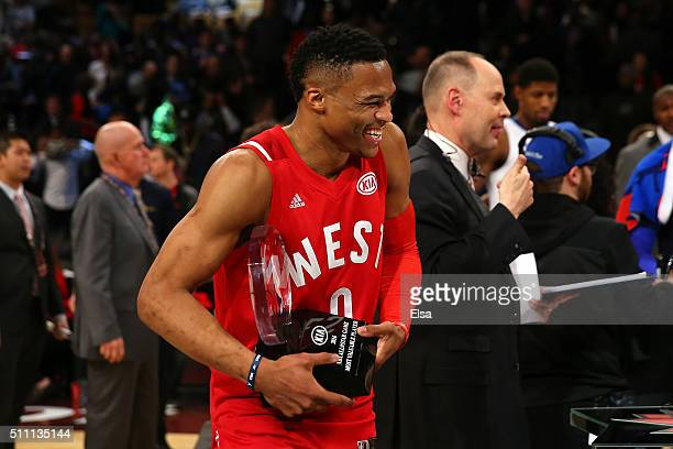 Russell Westbrook of the Oklahoma City Thunder and the Western Conference holds the MVP trophy after defeating the Eastern Conference during the NBA...