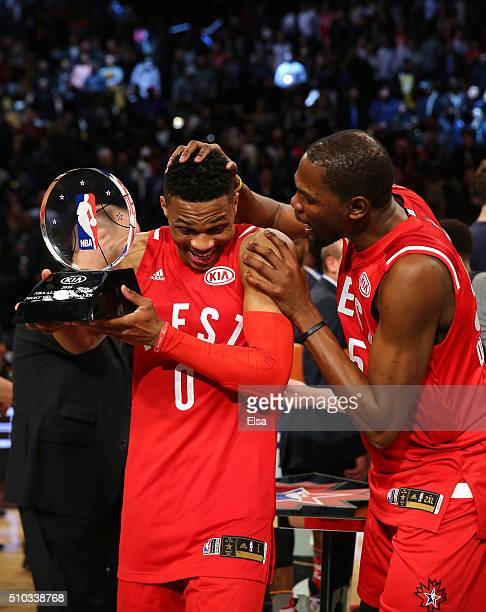 Russell Westbrook of the Oklahoma City Thunder and the Western Conference is congratulated by teammate Kevin Durant after defeating the Eastern...