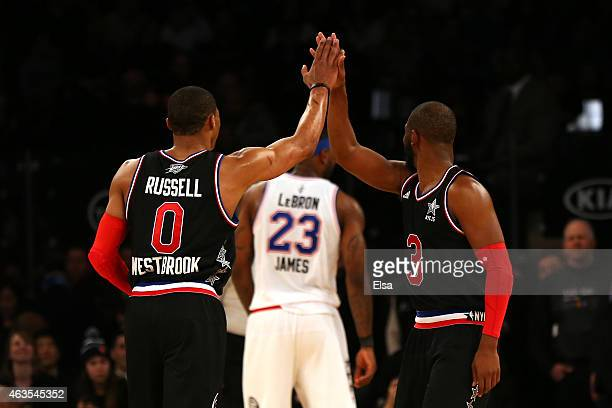 Russell Westbrook of the Oklahoma City Thunder and the Western Conference highfives Chris Paul of the Los Angeles Clippers and the Western Conference...