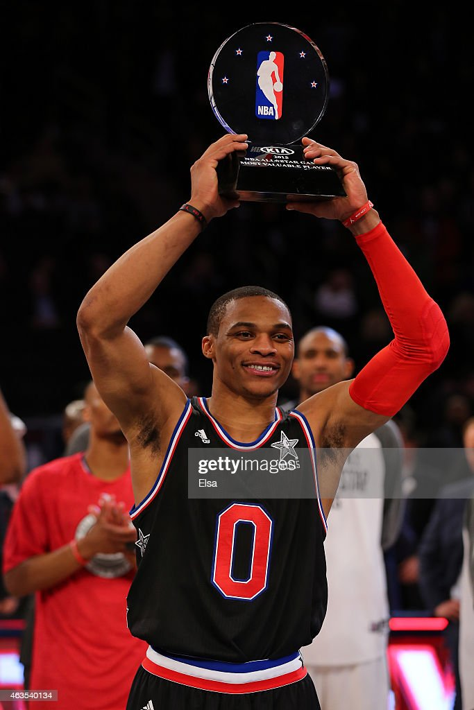 Russell Westbrook of the Oklahoma City Thunder and the Western Conference celebrates after winning the MVP Trophy after defeating the Eastern...