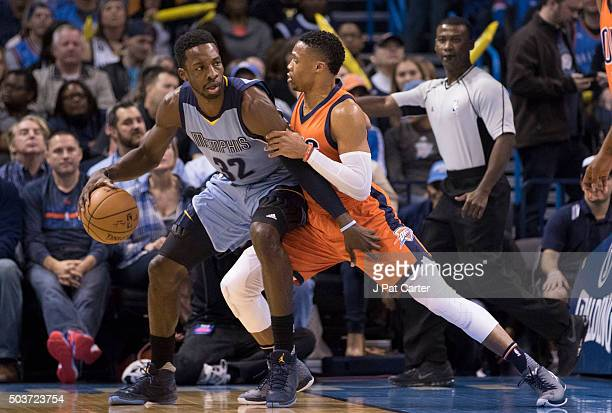 Russell Westbrook of the Oklahoma City Thunder applies pressure as Jeff Green of the Memphis Grizzlies looks for a play during the first quarter of a...