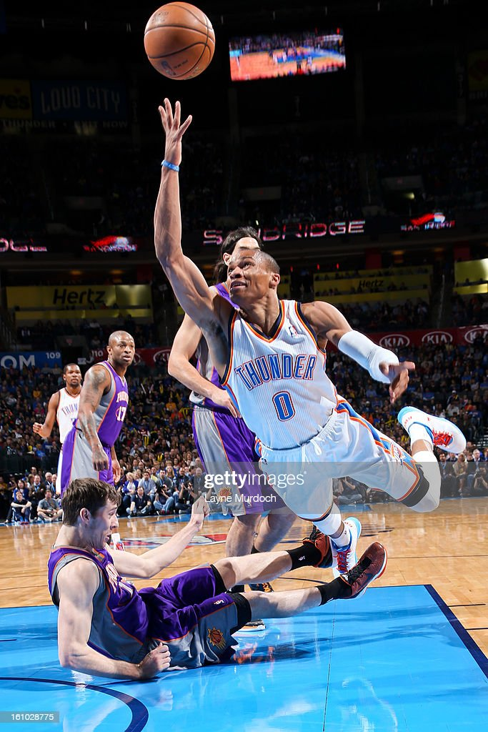 Russell Westbrook #0 of the Oklahoma City Thunder attempts a shot while falling in the lane against Goran Dragic #1 of the Phoenix Suns on February 8, 2013 at the Chesapeake Energy Arena in Oklahoma City, Oklahoma.