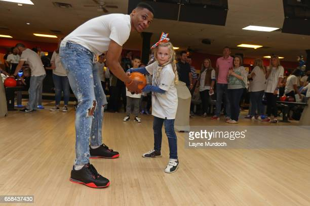 Russell Westbrook of the Oklahoma City Thunder bowls with kids during his 7th annual Why Not Foundation bowling event on March 24 2017 at the AMF...