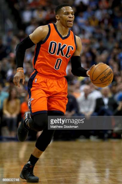 Russell Westbrook of the Oklahoma City Thunder brings the ball down the floor while playing the Denver Nuggets at Pepsi Center on April 9 2017 in...