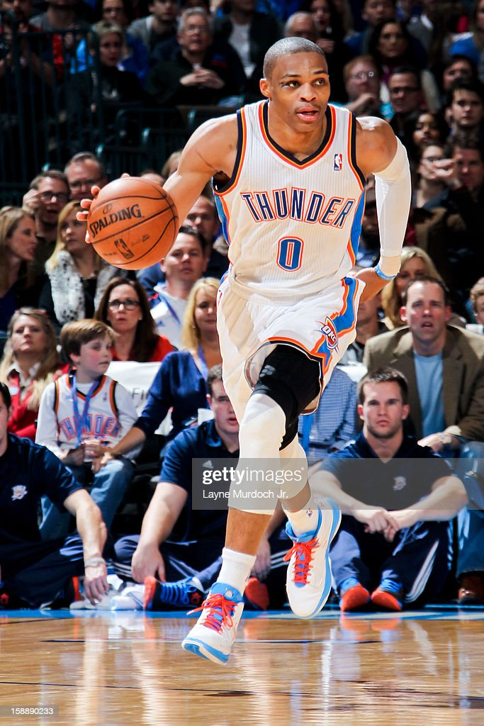 <a gi-track='captionPersonalityLinkClicked' href=/galleries/search?phrase=Russell+Westbrook&family=editorial&specificpeople=4044231 ng-click='$event.stopPropagation()'>Russell Westbrook</a> #0 of the Oklahoma City Thunder brings the ball up court against the Brooklyn Nets on January 2, 2013 at the Chesapeake Energy Arena in Oklahoma City, Oklahoma.