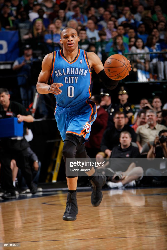 <a gi-track='captionPersonalityLinkClicked' href=/galleries/search?phrase=Russell+Westbrook&family=editorial&specificpeople=4044231 ng-click='$event.stopPropagation()'>Russell Westbrook</a> #0 of the Oklahoma City Thunder brings the ball up court against the Dallas Mavericks on March 17, 2013 at the American Airlines Center in Dallas, Texas.