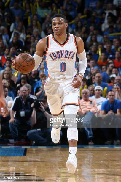 Russell Westbrook of the Oklahoma City Thunder brings the ball up court during the game against the Denver Nuggets on April 12 2017 at Chesapeake...