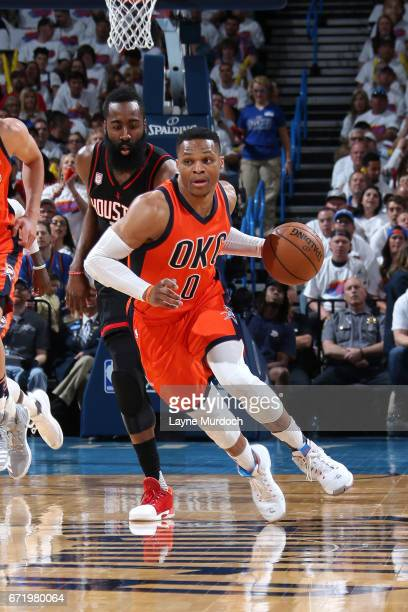 Russell Westbrook of the Oklahoma City Thunder brings the ball up court during the game against the Houston Rockets in Game Four during the Western...