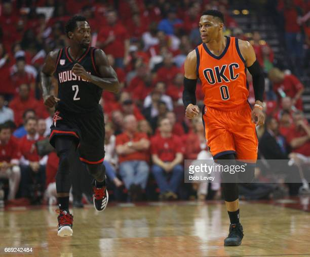 Russell Westbrook of the Oklahoma City Thunder brings the ball up the court as Patrick Beverley of the Houston Rockets follows during Game One of the...