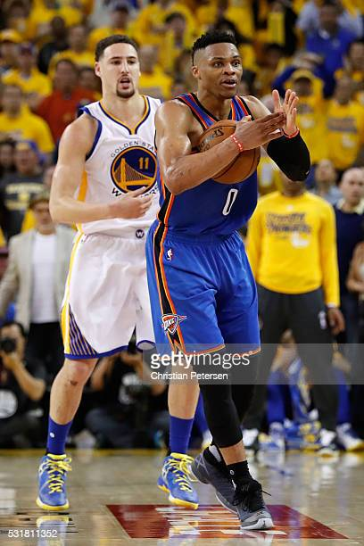 Russell Westbrook of the Oklahoma City Thunder calls timeout in the fourth quarter against the Golden State Warriors during game one of the NBA...