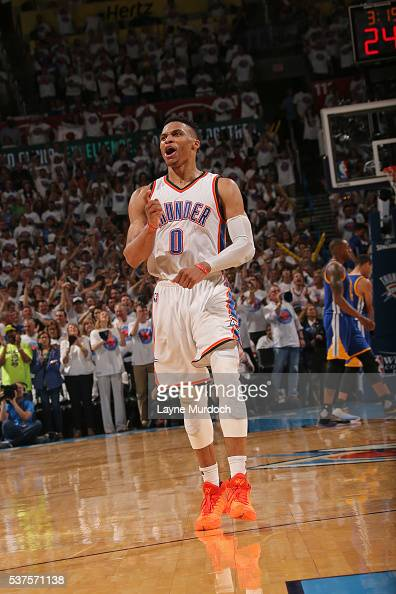 Russell Westbrook of the Oklahoma City Thunder celebrates a shot as he runs up court against the Golden State Warriors in Game Four of the Western...
